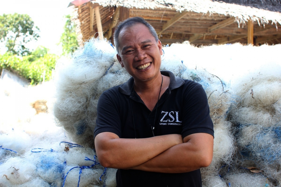 "NetWorks' Philippines director Amado Blanco says the key to the program is that local people ""can clean the environment and earn at the same time."" Fishermen and others on Guindacpan are paid for their work salvaging, cleaning and baling up the ghost nets"