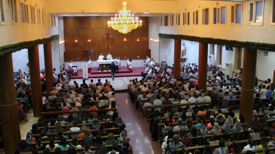 Christians, most displaced from their homes, pray in a church in Erbil in northern Iraq.