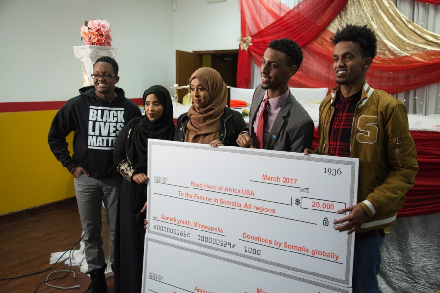 Group holds poster-size check