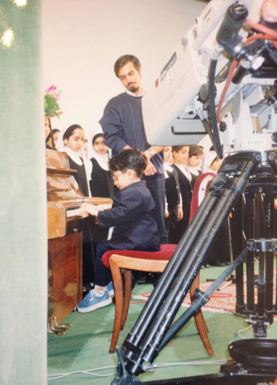 Four-year-old Amir Darabi on stage in Tehran.