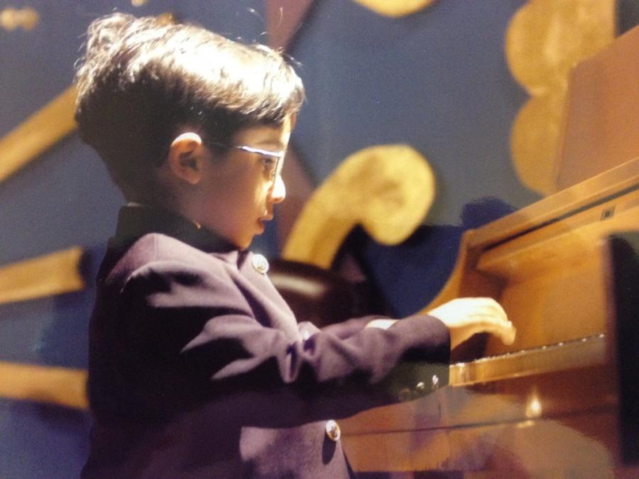 Four-year-old Amir Darabi on stage in Tehran.