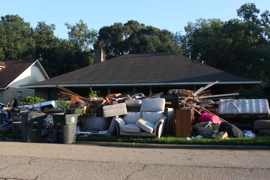 Piles of debris, like this one, are common outside homes across southeast Louisiana.