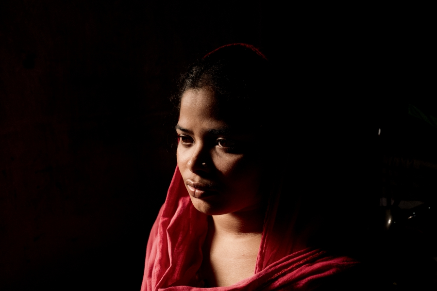Close up of a young woman wearing a red shawl.