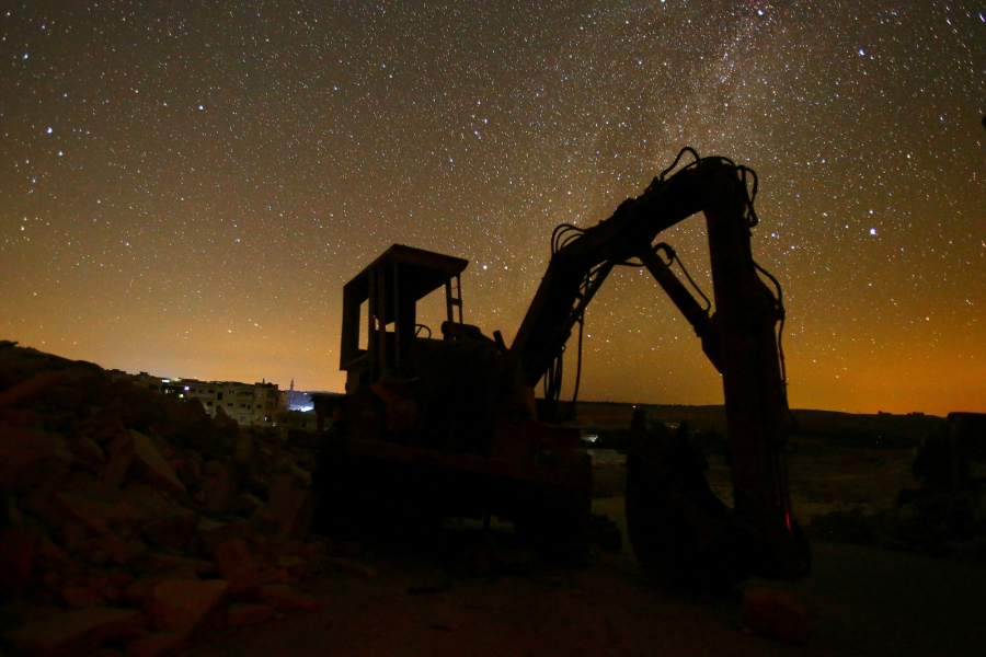 A digger stands amid the rubble in the rebel-controlled area of Maaret al-Numan in Idlib province.