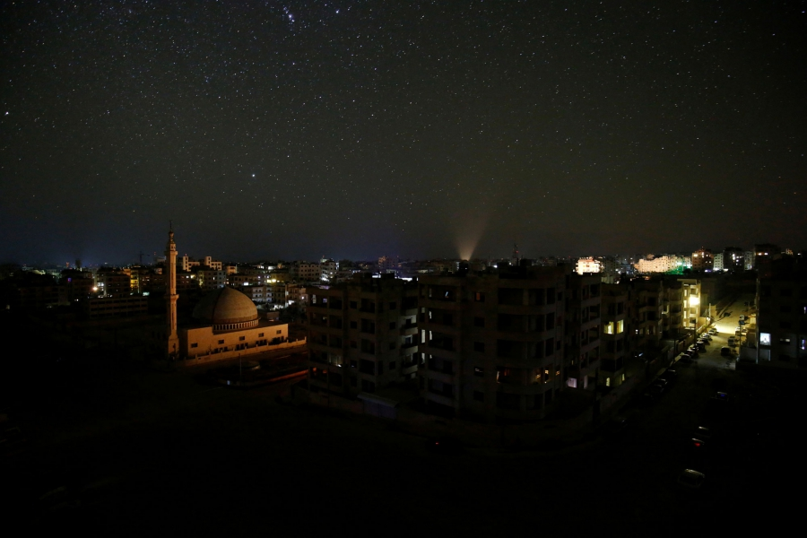 The city of Idlib is seen at night.