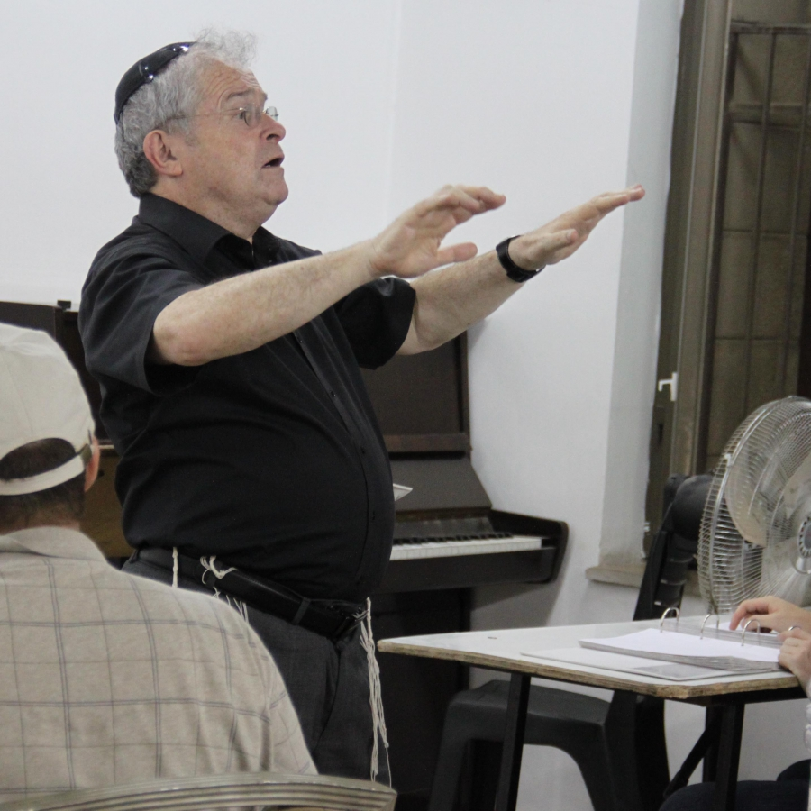 Elli Jaffe conducts the choir during practice at Jerusalem's Great Synagogue.