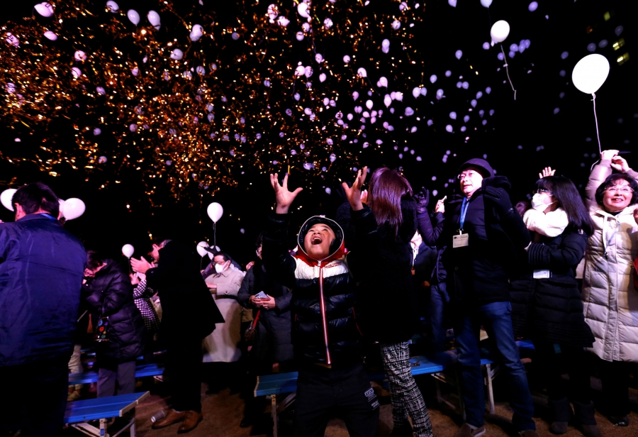 Revellers release balloons as they take part in New Year celebrations in Tokyo, Japan.