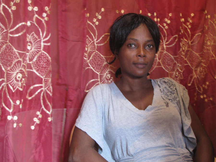 Lucilia Gérome Petit-Frère, President of the Association of Women of Potential of Village la Difference, sits in her living room in the village.