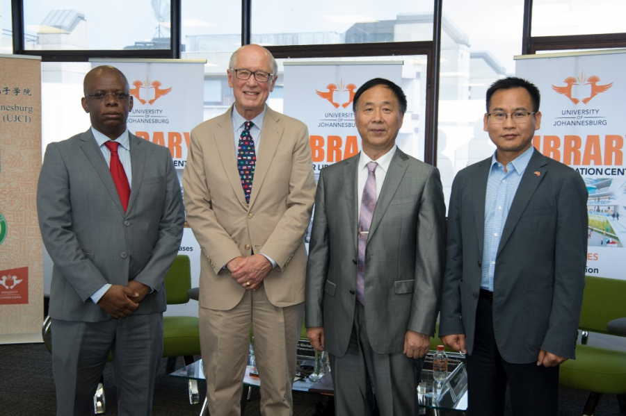 David Monyae, far left, codirector of the Confucius Institute at the University of Johannesburg, and John Stremlau, second from left, visiting professor of international relations at Witwatersrand University