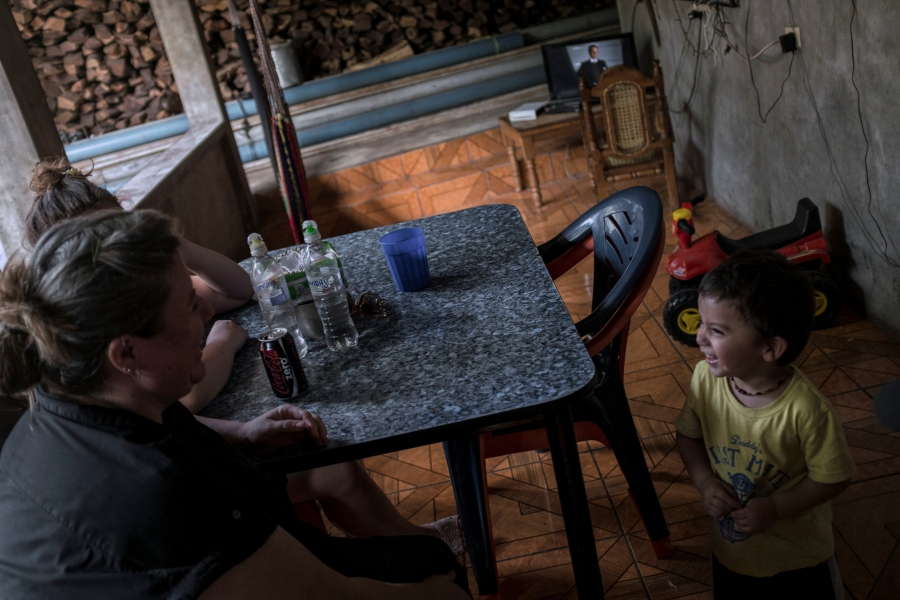 Andrea Hernandez plays with her 2yrs old son Elijah at their home in Sesuntepeque