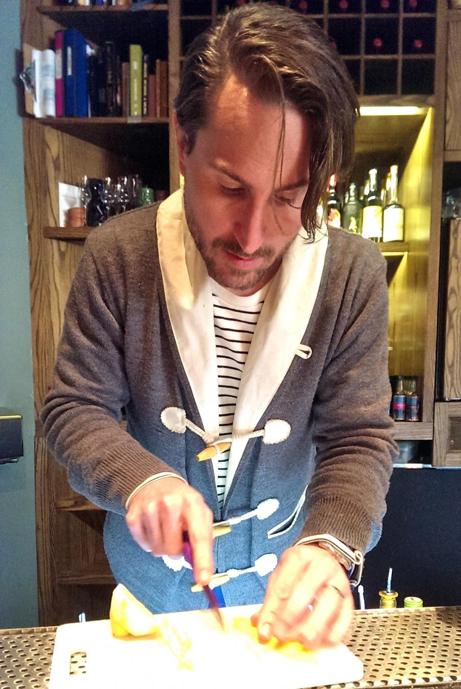 Joaquin Simo prepares cocktails