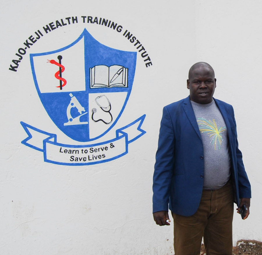 Lou Louis Koboji, the founder and director of the Kajo Keji Health Training Institute, stands outside the school's new location in Arua, Uganda.