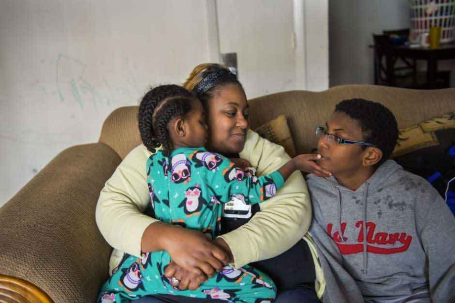 Lynchburg, Virginia resident Stacey Doss holds her toddler, B.J., while son Kayleb plays big brother. Doss, the daughter of a police officer, is outraged that a school resource officer arrested her son after he left a classroom without permission. The aut