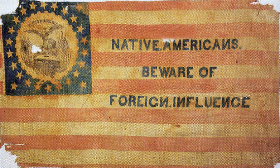 """Image of a flag used by the Know Nothing Party in the 1850s. It closely resembles with US flag, but is printed with the words """"Native Americans, beware of foreign influence"""""""