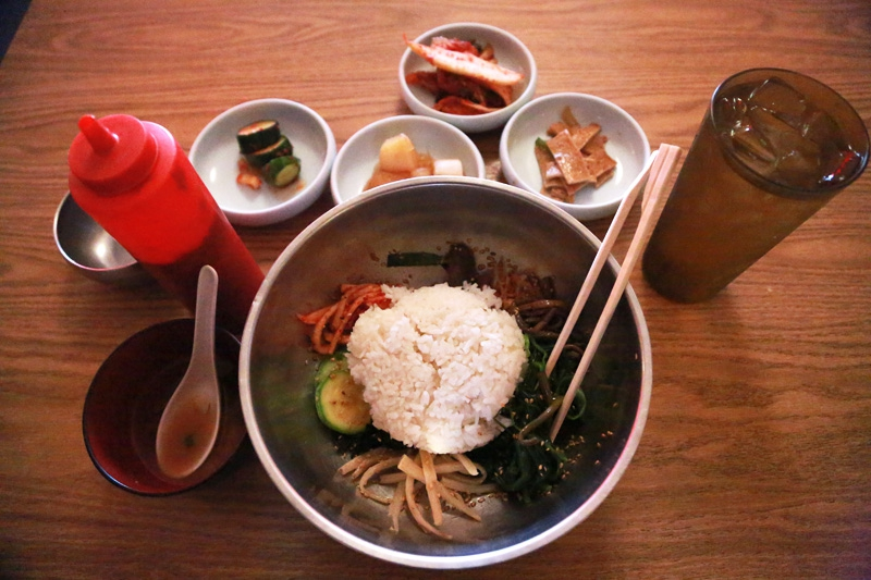 Bibimbap is one of the most popular dishes at Koreana restaurant in Killeen, Texas. It involves mounds of colorful sides, steamed rice and chili sauce.
