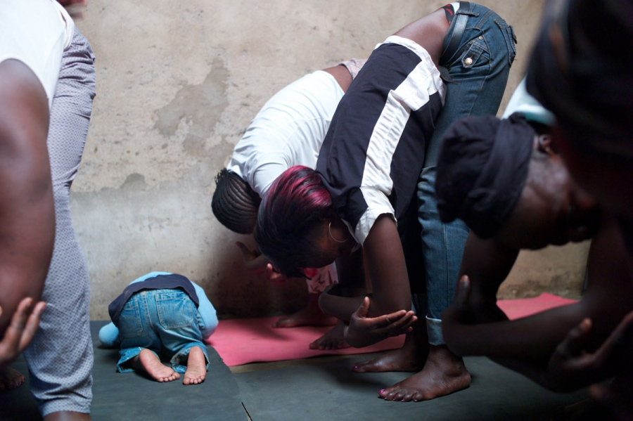 Students get the hang of the rag-doll pose in a class for girls and young mothers in Kariobangi.