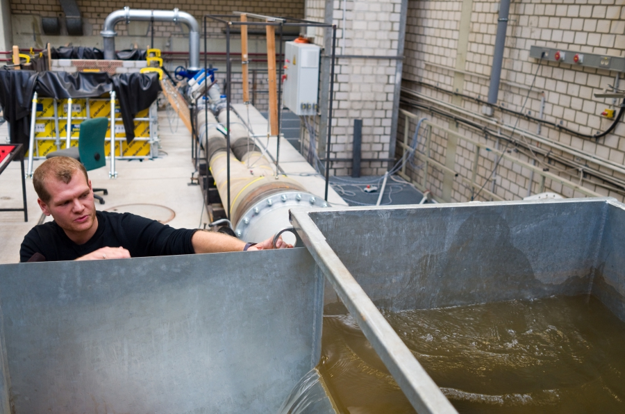 Research assistant Jonas Nienhaus operates a partial model of the planned pumped storage system researchers are hoping to build inside the soon-to-be-closed Prosper-Haniel coal mine.
