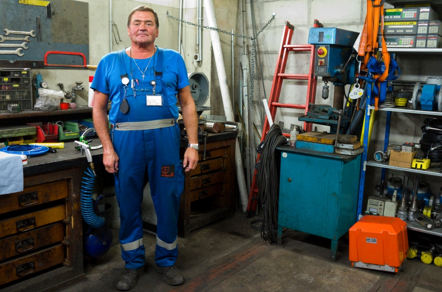 """Ernst Mueller stands in his Prosper-Haniel machine shop. """"The mine has done right by me,"""" he says."""