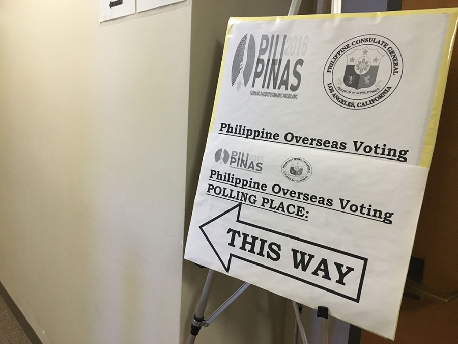 A sign with a big arrow to the Philippine polling place
