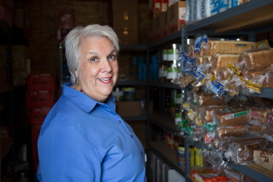 Janet Wilkerson, CAAIR's founder and CEO, shows off the pantry that feeds the participants in her recovery program.