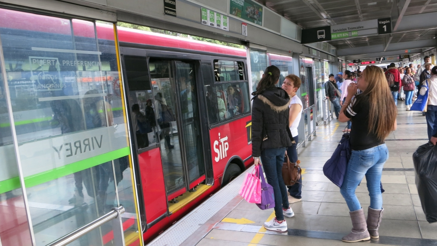 Bogotá's TransMilenio system operates like an above-ground subway with stations and quick boarding.