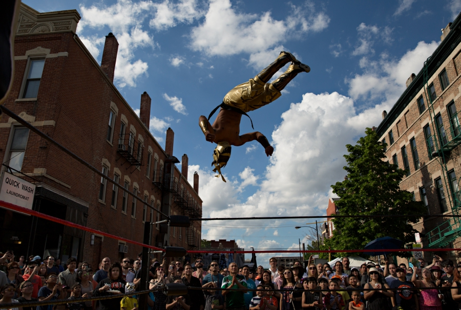 Man in air above wrestling ring
