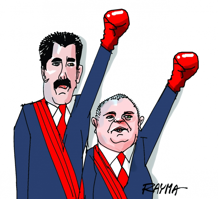 Venezuelan President Nicolas Maduro (left) and Diosdado Cabello (right), President of the National Assembly of Venezuela. Cabello's weekly program on state-run television is called Con el Mazo Dando (Hitting with the Sledge Hammer).
