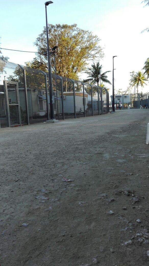 The wire fence that surrounds the Australian-funded immigration detention camp on Manus Island, Papua New Guinea, where Aziz has been held since October 2013.