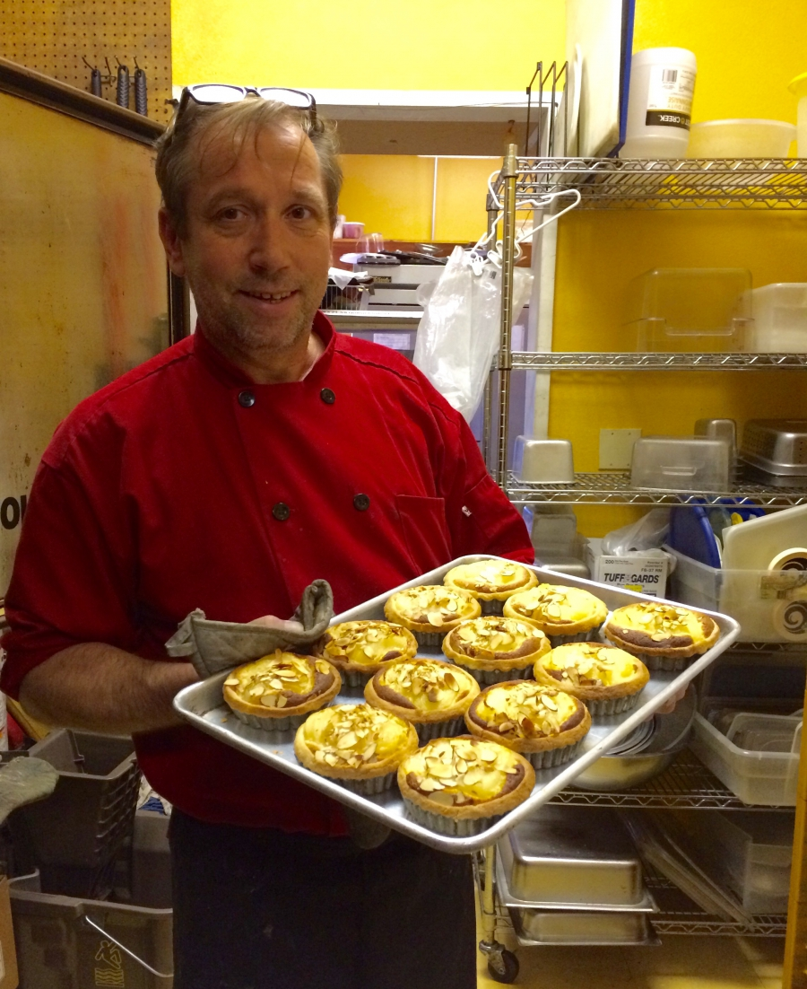 Chef Thierry Marceaux with a fresh batch of pastries at Le Rendez-vous Café in Las Cruces, New Mexico