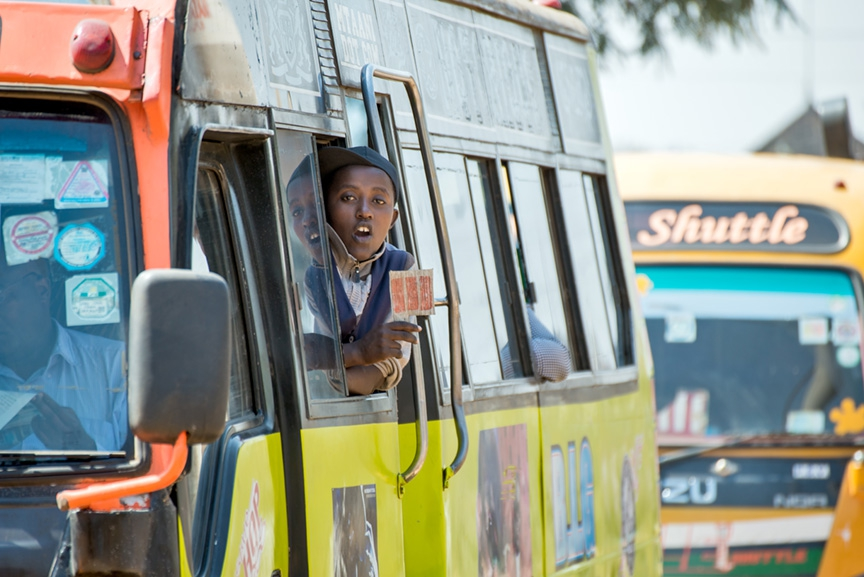 A stream of buses and matatus enter one of Nairobi's stations.