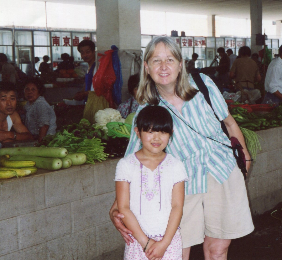 Maya and Melissa Ludtke in a market in Xiaxi, Jiangsu province in 2004, where Maya was born before Melissa adopted her.