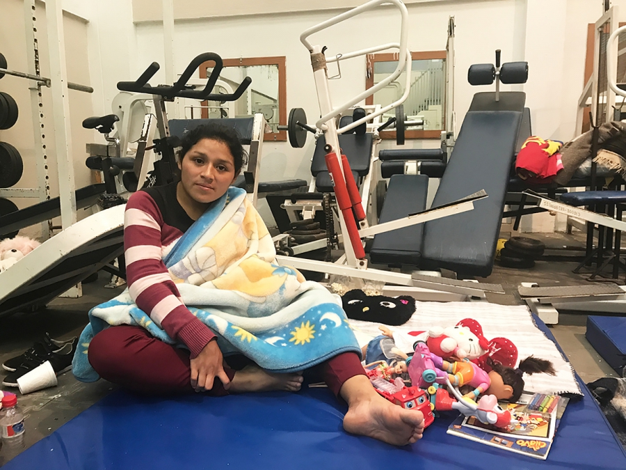 Jessica Cruz stays at a gym-turned-shelter Thursday fearing earthquake aftershocks.
