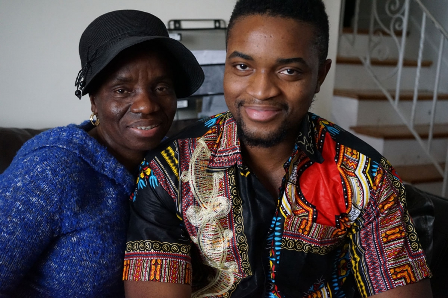 Mercy Krua, and her son Jefferson Krua, on her living room couch in Boston, MA.