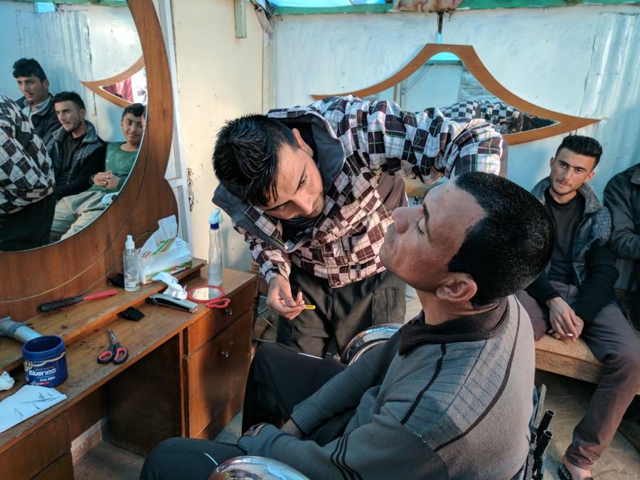 Kassem, a 25-year-old Yazidi barber, set up shop in a shack on top of Mount Sinjar.