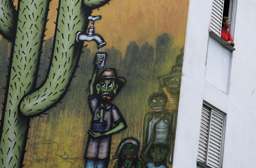 One of many murals around Sao Paulo commenting on the city's water crisis. Recent rains have brought a small measure of relief, but reservoir levels are still below 20% or capacity heading into the region's dry season.
