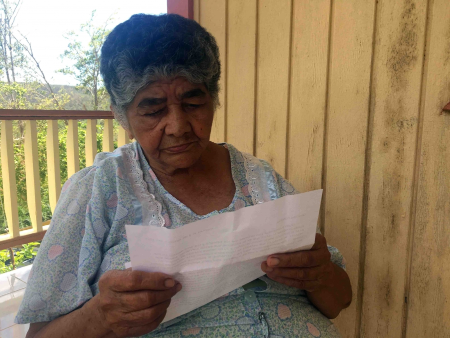 Close up of elderly woman reading a letter