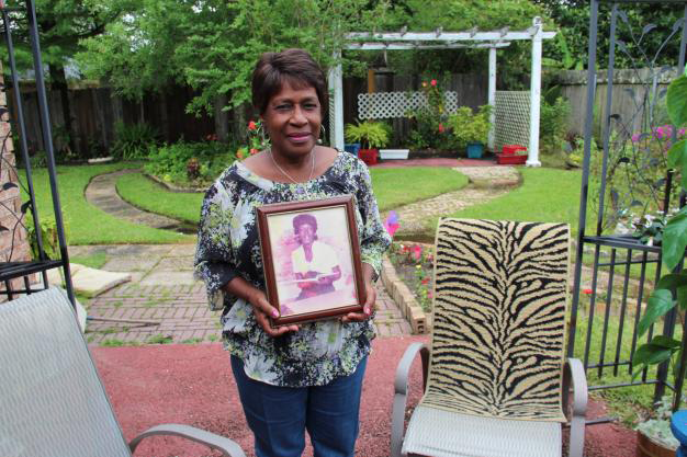 Margie Richard with a photo of her sister Naomi, who died at the age of 43 from a rare bacterial infection. Richard suspected emissions from Shell had something to do with making her sister sick.