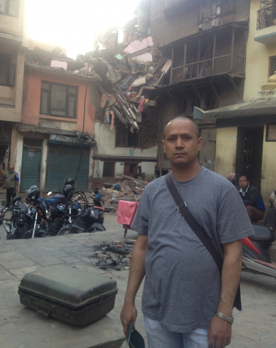 Rajesh Shrestha stands in front of his home in Nepal in March of this year.