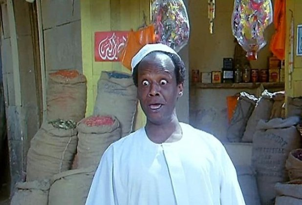 """A still from the Egyptian film """"Mahatet Elons."""" Nubians are often stereotyped as dumb doormen."""