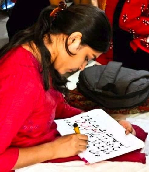 Nusrat Ansari practices her Urdu writing skills.
