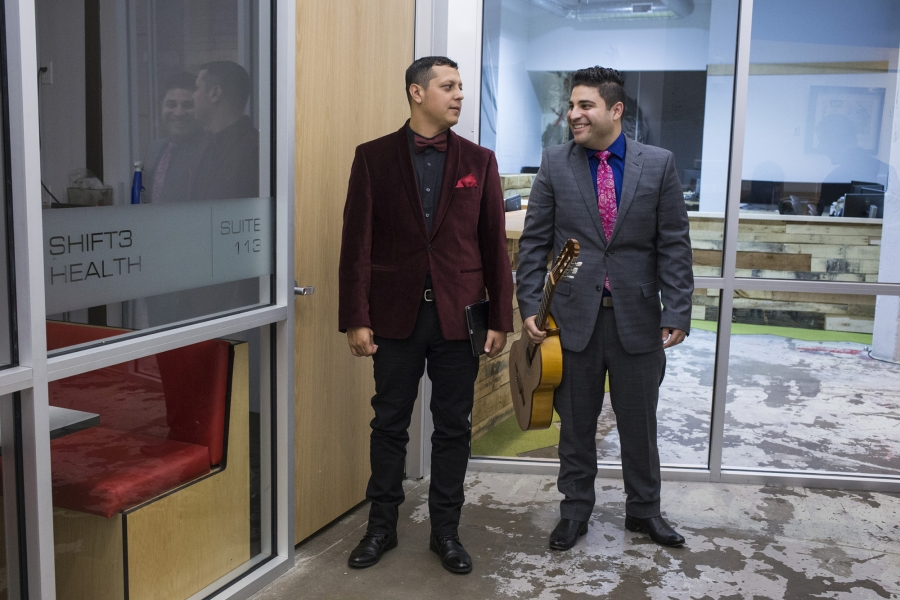 Omar and his collaborator, violinist Patrick Contreras, wait outside the theater before going on stage for their show, VIVO.