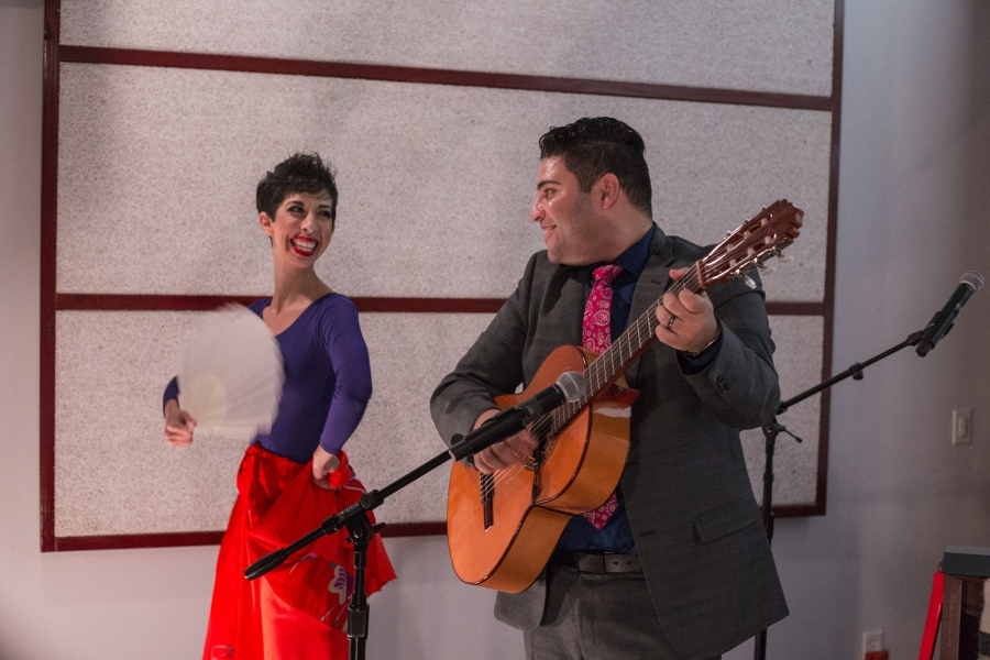 Omar locks eyes with his wife, Jasmín, on stage as violinist Patrick Contreras makes his way offstage and into the crowd during the final number of their performance.