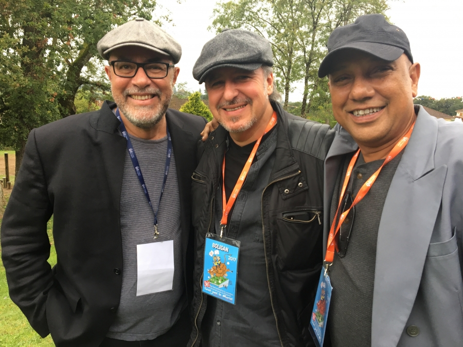 Angel Boligán, center, flanked by two fellow cartoonist friends from Cuba: Osmani Simanca, left, who now lives in Brazil and Ares, right, who lives in Havana.