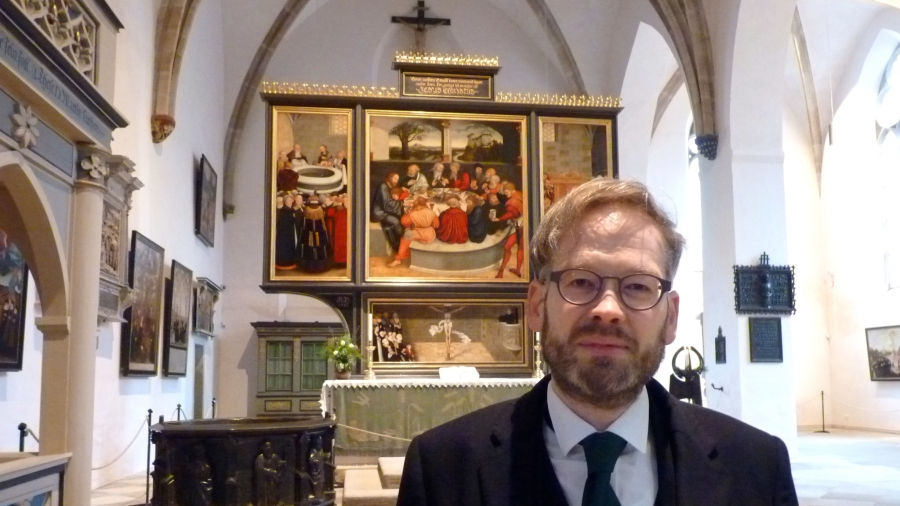 Pastor Johannes Block preaches in Town Church, where Martin Luther preached nearly 500 years ago.