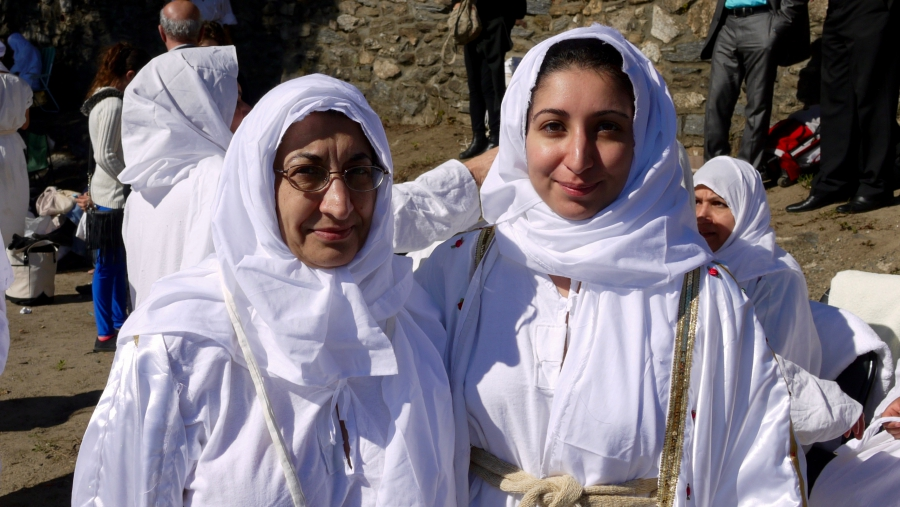 Noor Roomi (left) and her daughter Rand Nashi, both born in Iraq, were not going to miss an opportunity to be baptized by the Mandaean high priest Sheikh Salah, who recently visited the city of Worcester to preside over a communal baptism with several doz