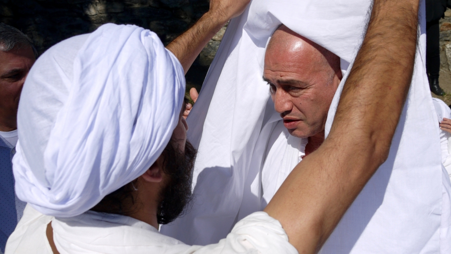 Wisam Breegi (right) prepares to be baptized by a visiting Mandaean high priest. Breegi is hoping to raise funds to build a Mandaean temple in the Worcester area.
