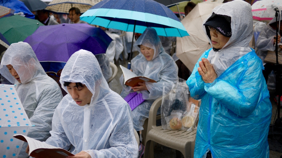 South Korean Buddhists tried to stay dry during this year's event.