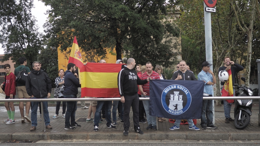 People carried a Spanish flag near a voting center where voters were taking part in a banned Catalan independence referendum.