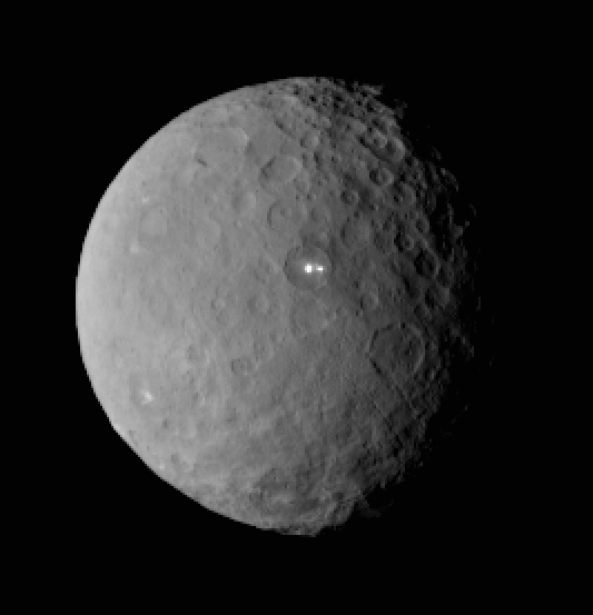An image taken by Dawn on Feb. 19 of two bright spots on Ceres.