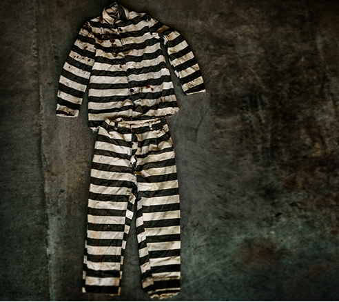 "Melissa Howard, owner of Stock Vintage: A recently acquired 1940s prisoner's outfit from Joplin, Missouri. ""It's very unusual to find a prisoner's outfit because people tend not to preserve them. What's unique about this particular piece is the man was ac"